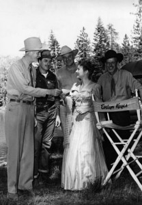 "Actress Evelyn Keyes receives an invitation to a local community event from Judge Jack Mathew's and Constable Coy Brown, while filming ""Mrs. Mike"" in 1949."
