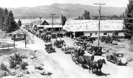 This 1920's parade is coming up Pine Knot Boulevard. Big Bear Lake can be seen in the backgound.