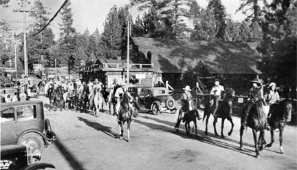 This parade down Village Drive was the forerunner of today's Old Miners Days parade. The Big Bear Pavilion is in the background.