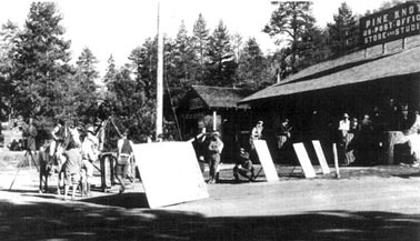 """Manager Fred """"Dad"""" Skinner worked overtime promoting Big Bear and the lodge with the movie industry. This photo shows an early western being filmed in front of the main pavilion. - Rick Keppler Collection."""