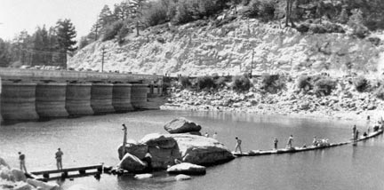 Occasionally the lake level drops low enough to expose the submerged Rock Dam. When it does the Rock Dam becomes on of the most popular fishing spots on the lake as in this 1940's photo. - Rick Keppler Collection