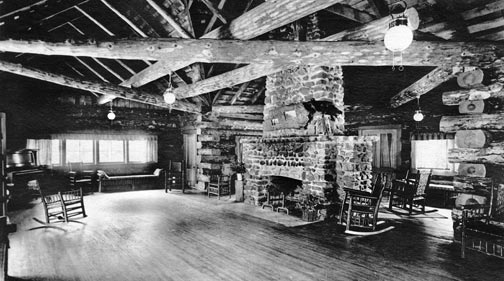 The interior of the main pavilion at Pine Knot Lodge.  Notice the gas lamps haning from the ceiling.  This photo was taken years before Big Bear had electricity.