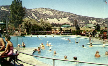 This view of the Peter Pan Woodland Club's unique figure eight shaped pool looks north across the golf course.  Today this is the east end of the runway at the Big Bear City airport. - Rick Keppler collection.