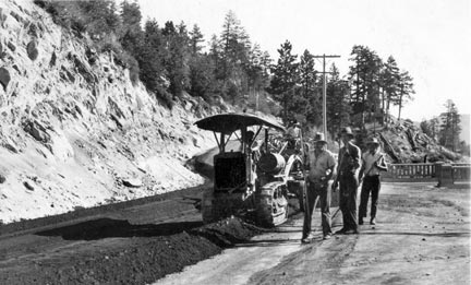 Workers preparing to lay asphalt on Highway 18 between the Big Bear Lake dam and Running Springs.