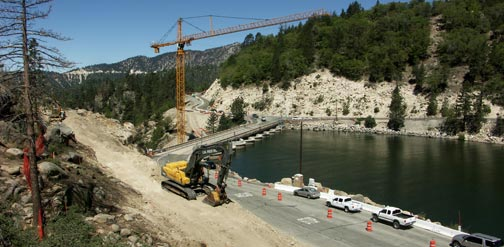 This May 23, 2009 image looks west from the north side of the lake. The new bridge will cross the valley behind and west of the existing dam, and connect at the top of the new road cut above the existing road. © Rick Keppler