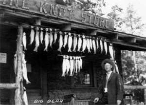 "Fre ""Dad"" Skinner in front of the General Store at Pine Knot lodge."
