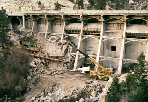 By December 1988, work on the Big Bear Lake dam is nearing completion.