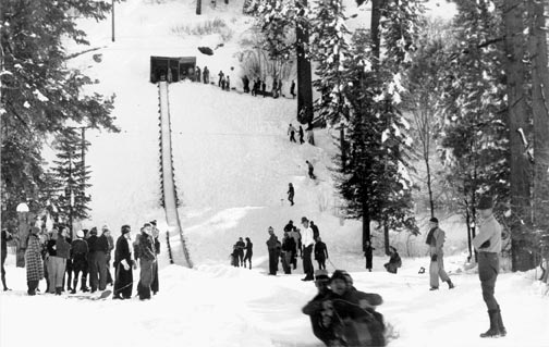 In 1934, Big Bear Lake gets a new toboggan run in the hills behind Big Bear Village.  It was built by the newly formed Big Bear Valley Park District to stimulate winter business.