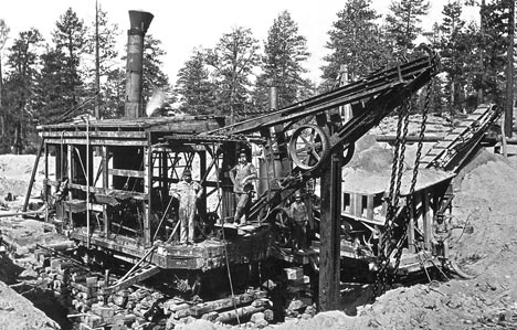 The Valley Gold Company Ltd. steam shovel at work in Holcomb Valley. The seperator, or grizzly, can be seen on the right.