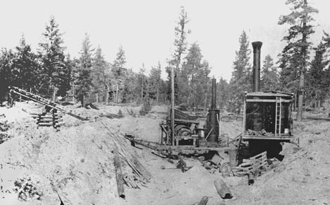 Here is a rear view of the Valley Gold Company Ltd. steam shovel and grizzly working their way across Holcomb Valley in the late 1800's. - Rick Keppler Collection.