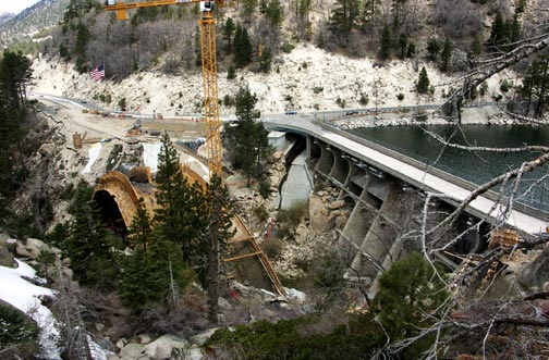 View of the valley showing the forms taking shape for the structural supports that will support the new bridge.