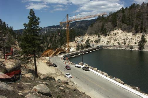 View looking west. The frame work for the bridge's structural support is just visable behind the dam.