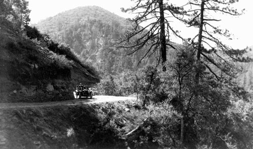 An old Model T works it's way to Big Bear Lake. The Rim Of The World Highway was strictly a summer time road. - Rick Keppler collection.