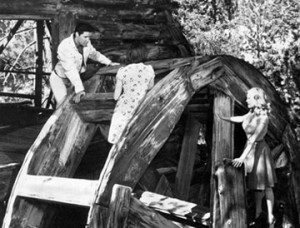 "Elvis in Big Bear on the old Cedar Lake mill, singing to his leading ladies on the set of his movie ""Kissing Cousins"". - Rick Keppler collection."