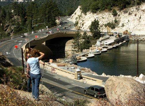 Jeanne Richards and Kaela Fengler check out the progress from the shore hillside. - © Rick Keppler.