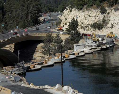 Removal of the old bridge across the Big Bear Lake Dam is nearly complete as of October 2, 2011.  Rick Keppler.