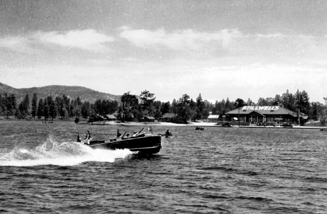 "One of the boats from the ""Step In Again"" fleet makes a high speed pass in front of the old Stillwell's resort. - Rick Keppler collection."