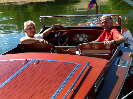 "Noel Blanc (left) with owner Cap Peckham (right) relax in the restored ""Step In Again 1"" at the Big Bear Lake Classic Boat Show. A Bit Of Trivia: Noel Blanc was on the second to last run that this boat made, before it was pulled from Big Bear Lake, back in the late 1940's. Noel was on board ""Step In Again 1"" for the second run on the lake when owners Cap and Barbara Peckham returned it to Big Bear over 60 years later. © Rick Keppler."